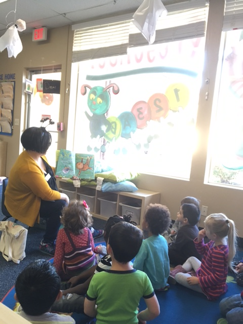 Image of Library On Wheels Storyteller reading to children