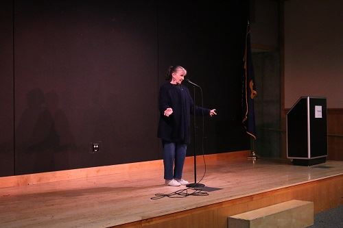 A patron telling a story during a story slam