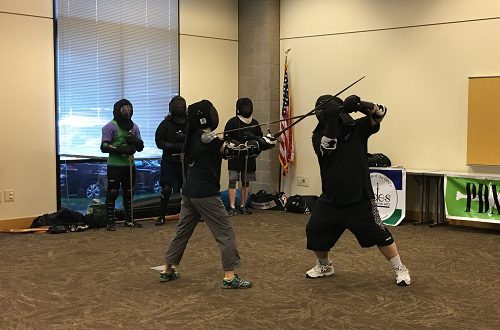 A medieval weapons demonstration in the Fight Like a Knight program