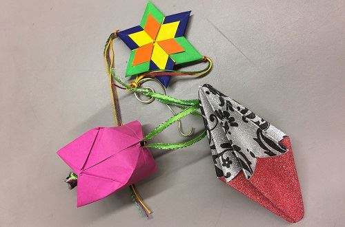 Origami ornaments made by patrons in Community Crafting for Adults