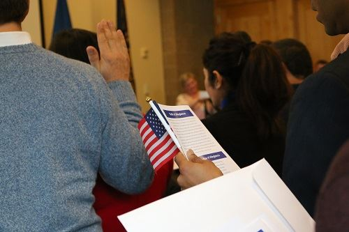 Patrons participating in the Naturalization Ceremony at the library
